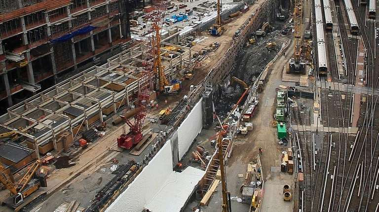 Ongoing construction of a rail tunnel, left, at