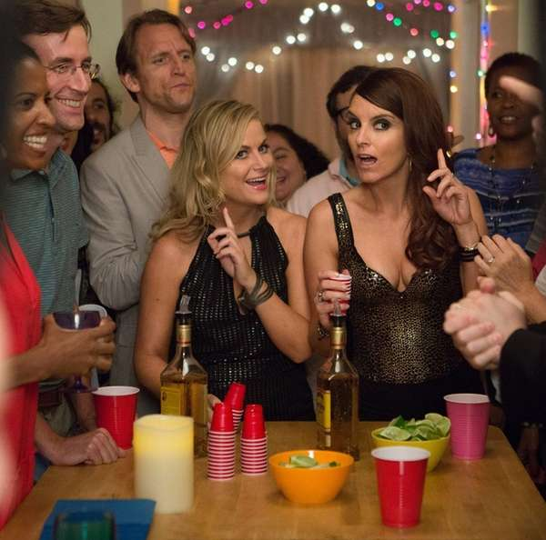 Amy Poehler, left, and Tiny Fey are party