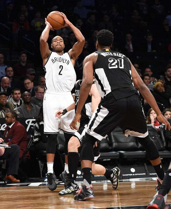 Brooklyn Nets guard Jarrett Jack hits his