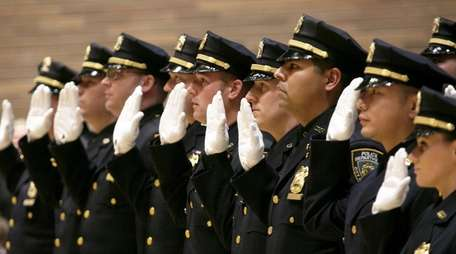 Members of the NYPD take the oath at