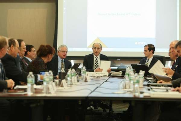 LIPA Board of Trustees Chairman Ralph Suozzi, center,
