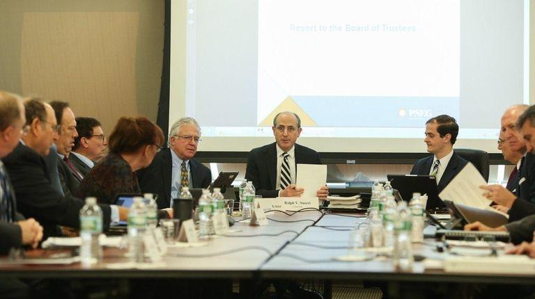 LIPA Board of Trustees Chairman Ralph Suozzi, center,