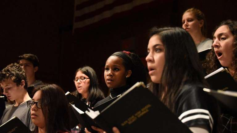 The Glen Cove High School Select Chorale rehearses