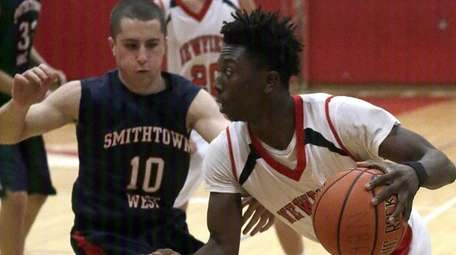 Newfield's Denzel Williams (24) drives against Smithtown West's