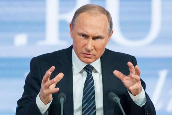Russian President Vladimir Putin gestures during his