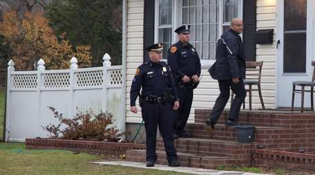 Suffolk County police investigate a home-invasion armed robbery