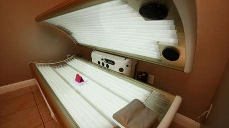 An open tanning bed is shown Dec.