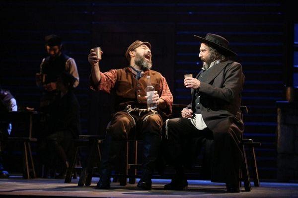Danny Burstein, left, as Tevye in