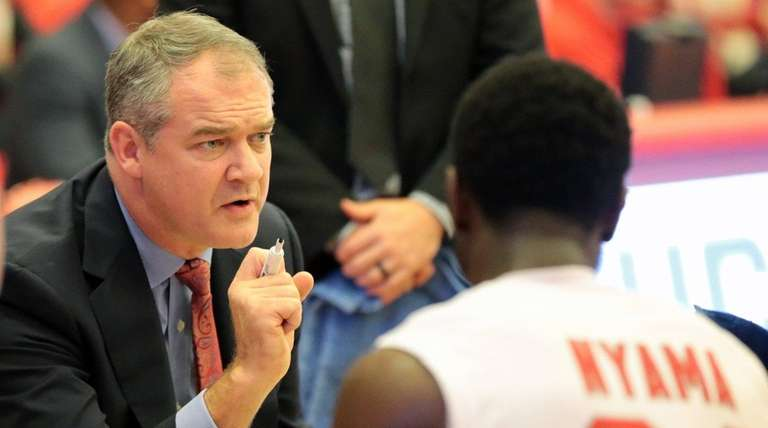 Defense-oriented Stony Brook coach Steve Pikiell, above, will