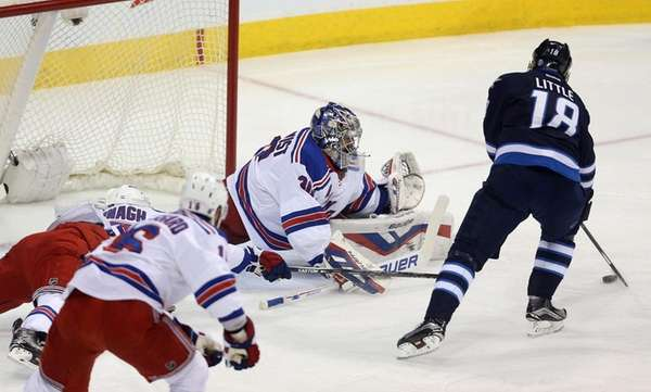 Winnipeg Jets' Bryan Little opens the scoring as