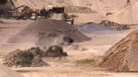 Mulching and mining operations are shown at a