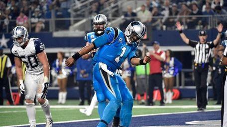 Panthers quarterback Cam Newton celebrates after running