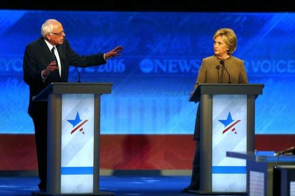 Bernie Sanders, left, offers an apology to Hillary