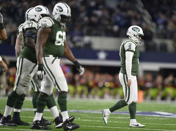 New York Jets kicker Randy Bullock (R) walks