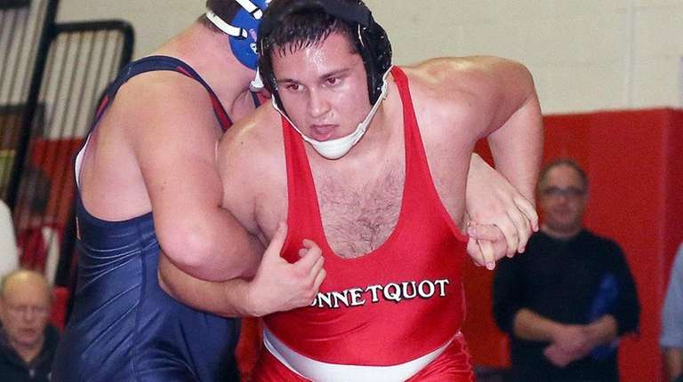 Connetquot's Gregor Malkasian wins his 220-pound match at