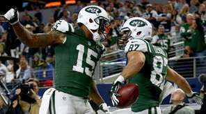 Brandon Marshall and Eric Decker celebrate after Decker's