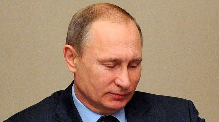 Russian President Vladimir Putin attends a Security Council