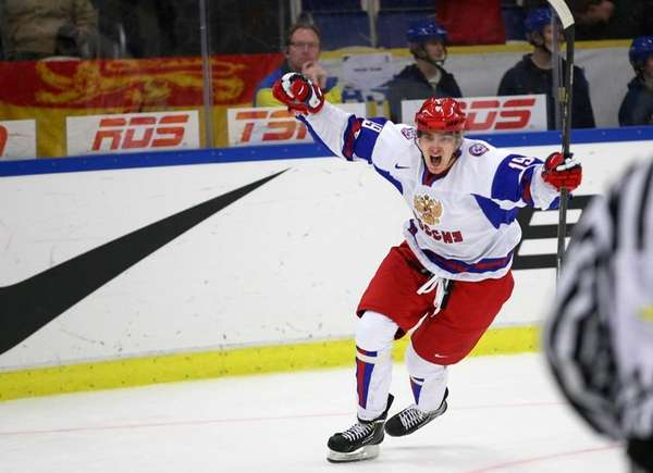 Russia's Pavel Buchnevich celebrates after scoring an empty-net