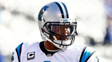 Cam Newton #1 of the Carolina Panthers warms