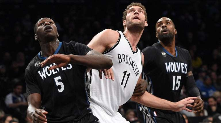 Brook Lopez finds himself sandwiched between Timberwolves' Gorgui