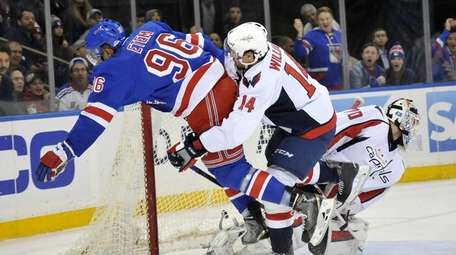 Justin Williams of the Capitals wraps up Emerson