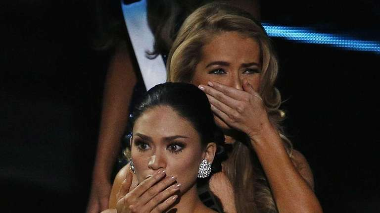 Miss Philippines Pia Alonzo Wurtzbach, front, reacts after