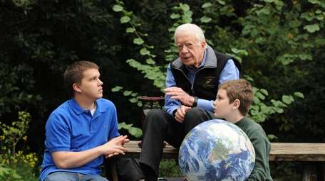 Jimmy Carter walks with his grandsons Jeremy Carter,