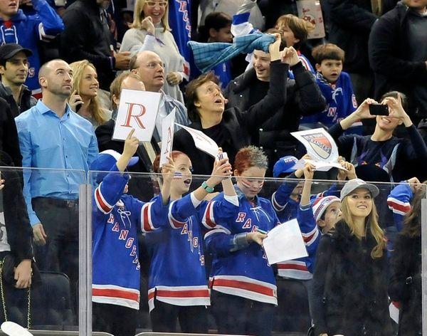 Sir Paul McCartney waves his towel to celebrate