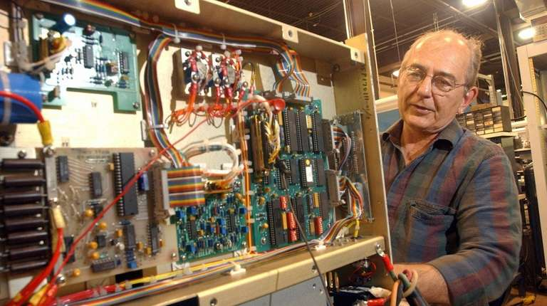 Technician Charles Dziomba tests an amplifier Thursday May