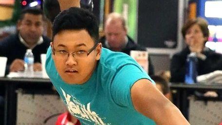 Division's Brandon Soedarmasto fires down the lane during