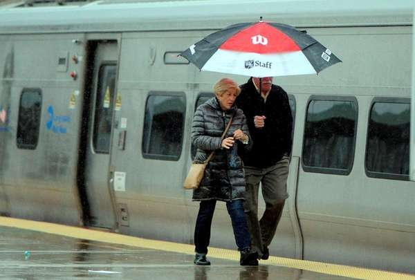 A couple walks on the platform at the