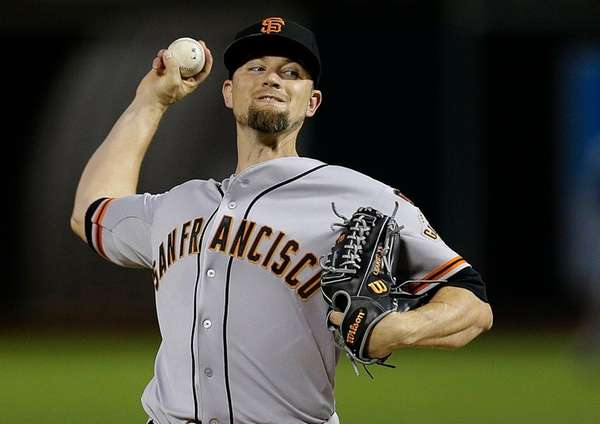 San Francisco Giants pitcher Mike Leake works