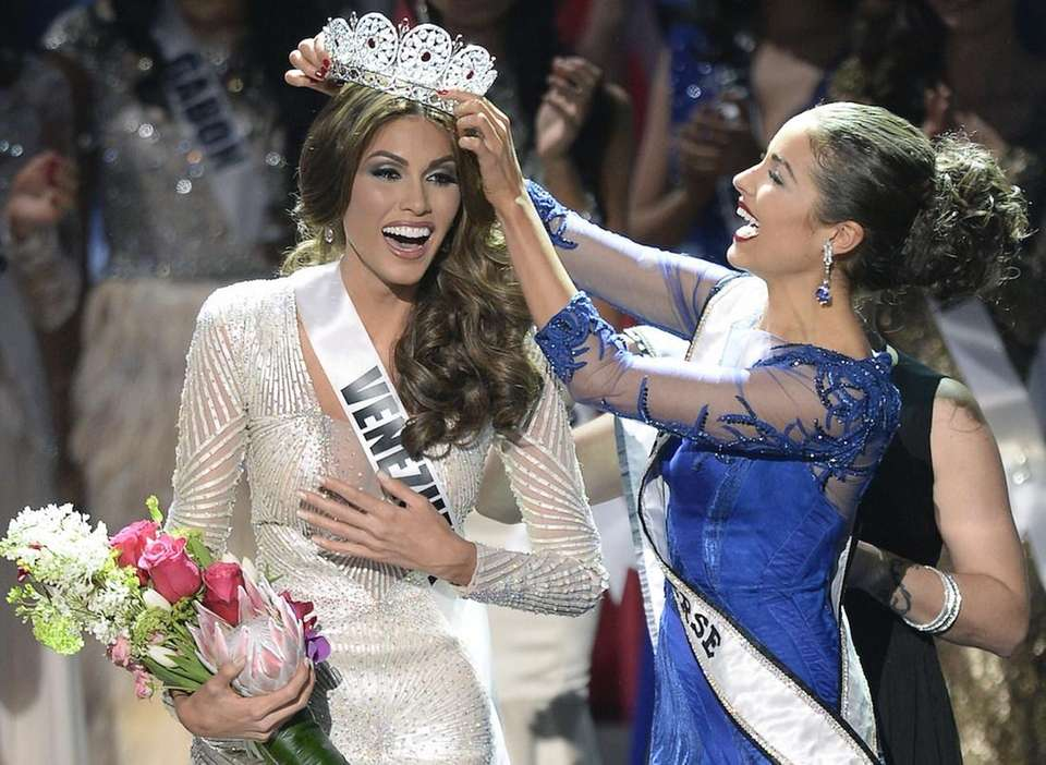 Miss Venezuela Gabriela Isler reacts as she receives