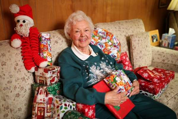 Gladys Fristrom, 89, surrounded by Christmas gifts sent