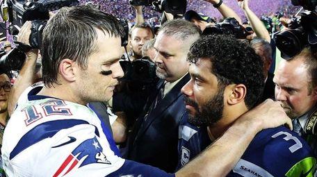 Russell Wilson of the Seahawks congratulates Tom Brady