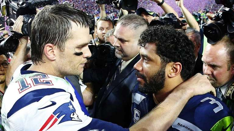 Russell Wilson of the Seahawks congratulates Tom Brady
