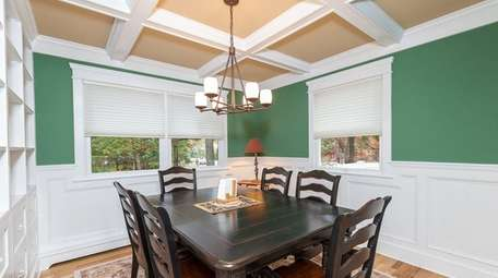 In addition to the dining room's coffered ceilings,