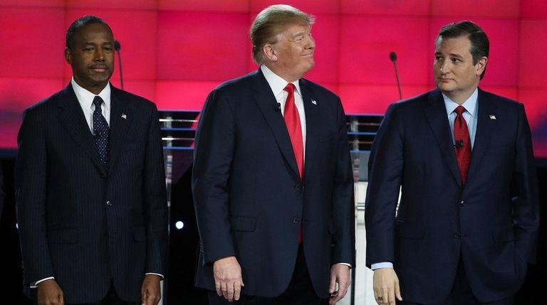 Republican presidential candidates Ben Carson, Donald Trump and