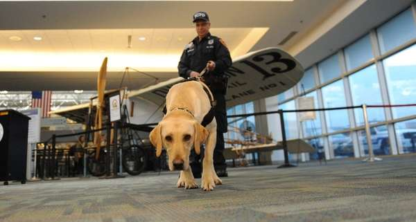 Suffolk County police officer Mike Canavaciol, with his