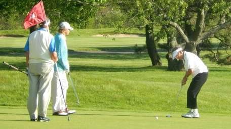 A group plays through on the golf course