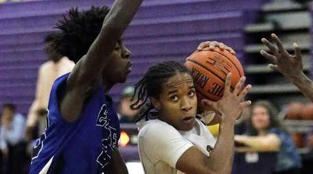 Central Islip's Justin Headley (3) drives against Copiague's