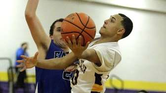 Central Islip's Angel Jimenez (23) gets off the