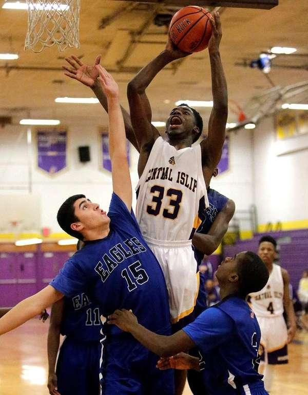 Central Islip's My'Quel Matthews (33) jumps over Copiague's