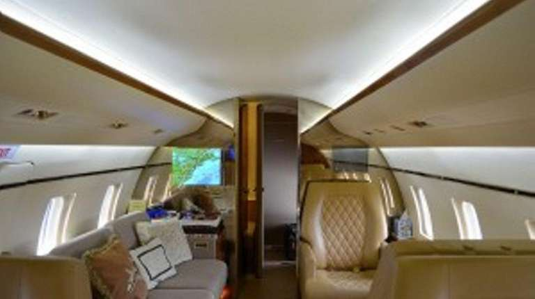 Interior of private/corporate jet that are illuminated with