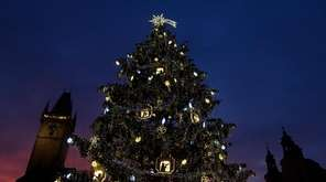 An illuminated Christmas tree is seen at the