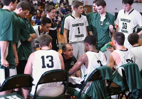 Harborfields head coach John Tampori directs his players