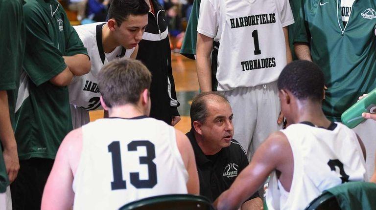 Harborfields head coach John Tampori directs his players