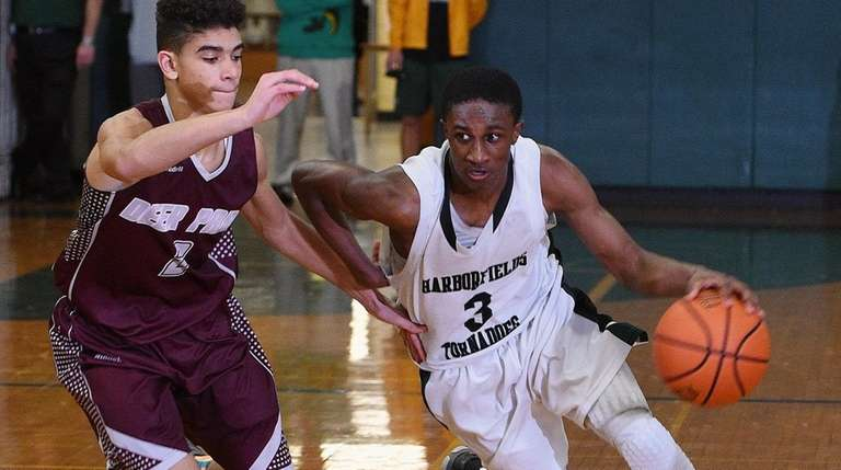 Harborfields' Malcolm Wynter dribbles past Deer Park defender