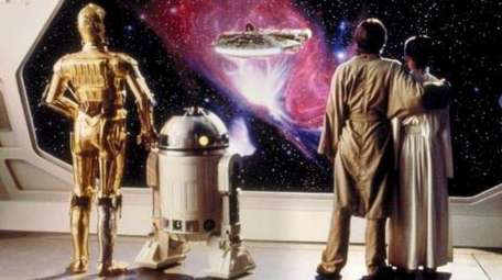From left, R2-D2, C-3PO, Luke Skywalker (Mark Hamill)