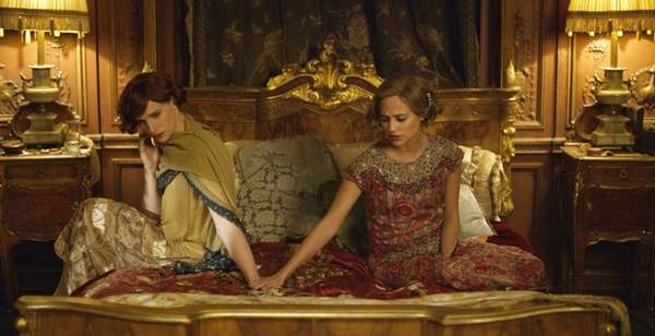 Eddie Redmayne, left, as Lili Elbe, and Alicia